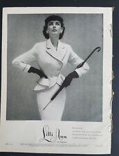 1952 women's Lilli Ann suit umbrella vintage fashion Richard Avedon photo ad