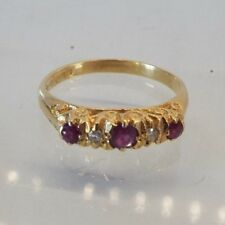 Hallmarked 18ct yellow gold ruby diamond stone ring with 3 rubies and 2 diamonds