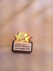 1984 L.A.Olympic Games  Pin Flying Stars White Background.