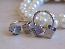 Horseshoe With Steel dices Nipple Ring.