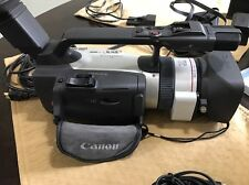 Canon GL2 Mini-DV camera package, padded carrying case, manual, accessories,