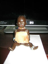 "VINTAGE CELLULOID AFRICAN 5 1/2"" BABY WITH PAINTED EYES & JOINTED BODY. GOOD CON"