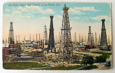 OLD CAR IN OIL WELLS SIGNAL HILL DISTRICT LONG BEACH CALIFORNIA CA POSTCARD