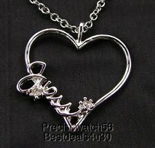 New with tags GUESS Womens necklace CHARM heart logo chain crystals  silver tone