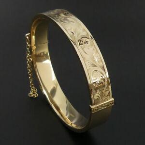 VINTAGE 9 CT GOLD ENGRAVED HINGED BANGLE BIRMINGHAM 1973 - 16 GRAMS