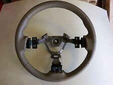 2005/06 Nissan Altima tan/beige leather 3 spoke factory wheel