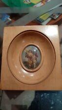 Cornice antica con miniatura al centro