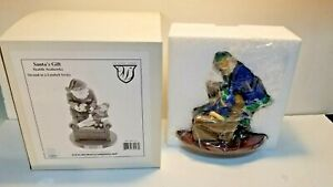Seattle Seahawks Santa Clause Figure with sleeping boy Christmas Limited Series