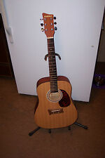 first-act acoustic guitar w/ hard shell case.