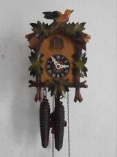Reloj de pared mecánico cuco antiguo alemán con péndulo y pesas con canto cucu