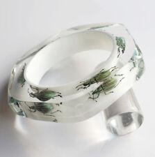 Avant garde white lucite bracelet with exotic metallic beetles