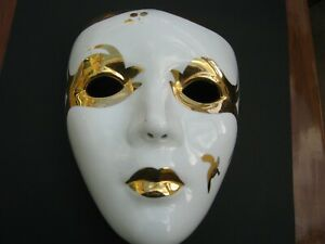 Decorative porclain face mask in White with gold detail.