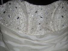 a stunning wedding dress in ivory taffeta