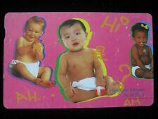"HongKong Telecom 80's - 90's Phonecard with 7 Eleven Logo - ""Babies""- used"