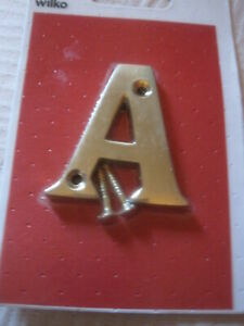 BRASS  LETTER   A  WILKO NEW LENGTH 3 INCHES WIDTH 1.75 INCHES WITH 2 SCREWS