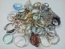 Lot of 38 rings. pre-owned. unmarked. with rhinestones + other stones. mixed