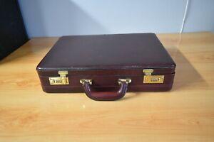 BURGANDY HARD SHELL BRIEF CASE WITH COMBINATION LOCKS