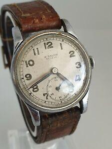 Vintage W Baume Geneve mens watch military? IN WORKING ORDER