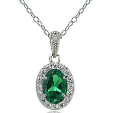 Sterling Silver Created Emerald and White Topaz Oval Halo Necklace
