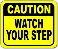 Caution watch your step Bright yellow metal outdoor sign