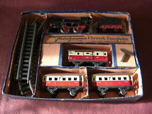 Uralte Fleischmann Eisenbahn Spur 0, Uhrwerk, Lok, Wagons, Gleise, Karton, rar