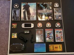 Sony PSP 2000 64MB Ice Silver Handheld System w/ charger, 6 games and 1 show