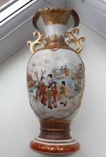 Antique Meji Japanese Kutani red and gilt two handled vase.
