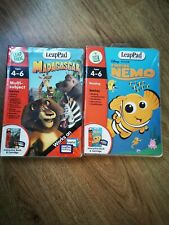 2x Leap Pad Learning System Books Cartridges Finding Nemo and Madagascar in case
