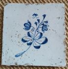 ANTIQUE 17C DUTCH DELFT TILE BLUE AND WHITE DEPICTING A FLOWER AND BUTTERFLY