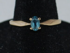 10k Yellow Gold Ring With A Solitaire Oval Cut Blue topaz (December birthstone)
