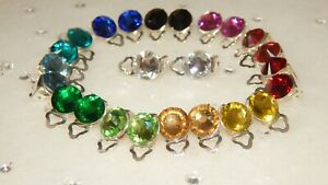 SILVER PLATED CLIP ON EARRINGS WITH 10MM FACETED RESIN RHINESTONES..16 COLOURS