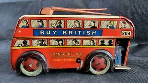 Vintage 1950's Wells Brimtoy London Transport Tin Plate Clockwork Trolley Bus