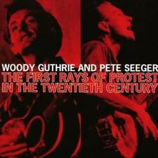 Woody Guthrie and Pete Seeger : The First Rays of Protest in the 20th Century