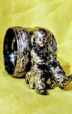 antique silverplated figural napkin ring, boy removing boots