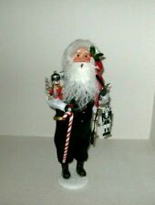 Byers choice, Nutcracker Santa w/ Nutcracker 2020 holds strap bells & Tag