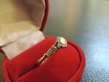 Bague solitaire or blanc 18 carats et zirconiums