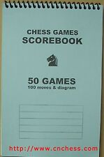 "QUALITY CHESS SCOREBOOKS, 8 1/2"" x 5 1/2"", orange, yellow, blue.  Holds 50 games"