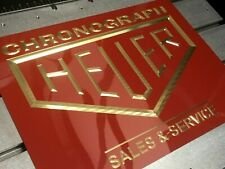 Heuer Sales & Service brass shop or retail display cabinet sign.