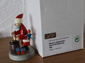 Alter Flade Weihnachtsmann mit Spielzeug in der OVP Erzgebirge  Rarität