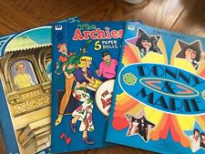 Uncut paper doll book lot The Archies, Donny and Marie, and Lost Horizon