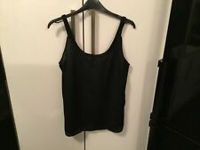 Only black scoop back top with beaded neck. Size 12(40). NWT
