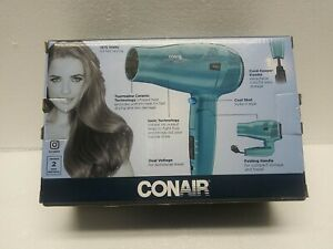 Conair 289TPN 1875 W Cord Keeper Travel Hair Dryer with Retractable Cord - Blue