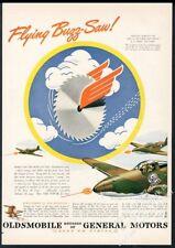 1943 Walt Disney Flying Buzz Saw 41st Fighter Squadron art Oldsmobile print ad