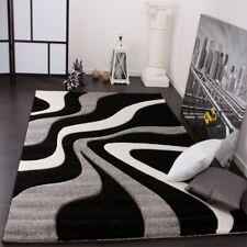 Designer Teppich mit Konturenschnitt Wellen Muster Schwarz Grau Weiss