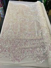 PINK PRINCESS IRIDESCENT SEQUINS ON A 4 WAY STRETCH WHITE MESH-SOLD BY YARD.
