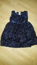 Party girls dresses size 6 in midnight blue. With sequins and flower ruffles.