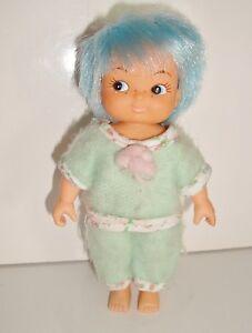 Poupée  VINTAGE DELAVENNAT 1987 famille Glady (11cm) dort bien vert