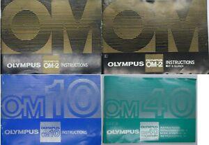 Four Olympus OM Instruction Books - OM2 (2), OM10, OM40
