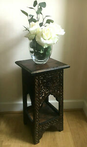 Carved wood dark plant table/side table