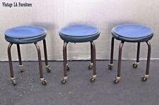 Three Vintage Mid Century Modern Industrial Blue Stools on Castors